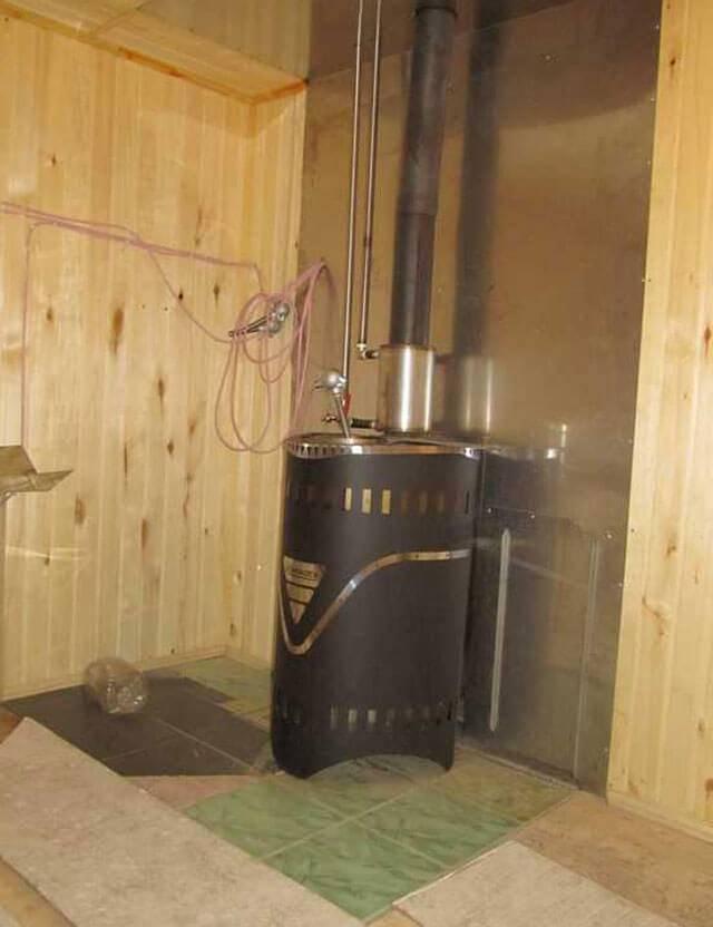 Защита стен бани от жара печи: минеритовые плиты, отделка железной печи, изоляция от стен, чем отделать, обшить ограждение, минерит для теплоизоляции