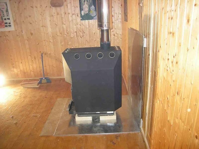 Как правильно установить печь в бане на деревянный пол?