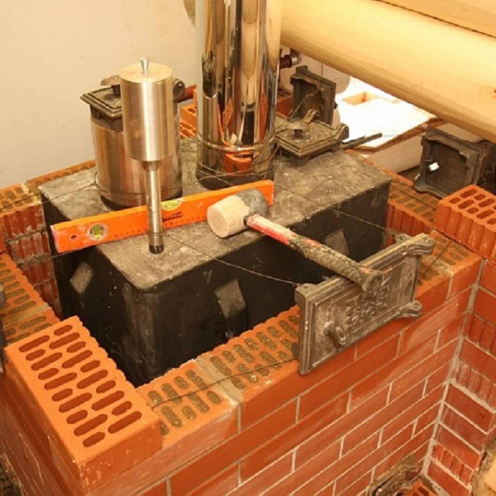 Как обложить железную печь в бане кирпичом своими руками?