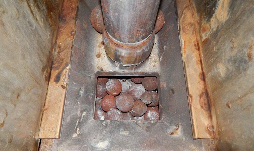 Правильно укладываем камни в банную печь.