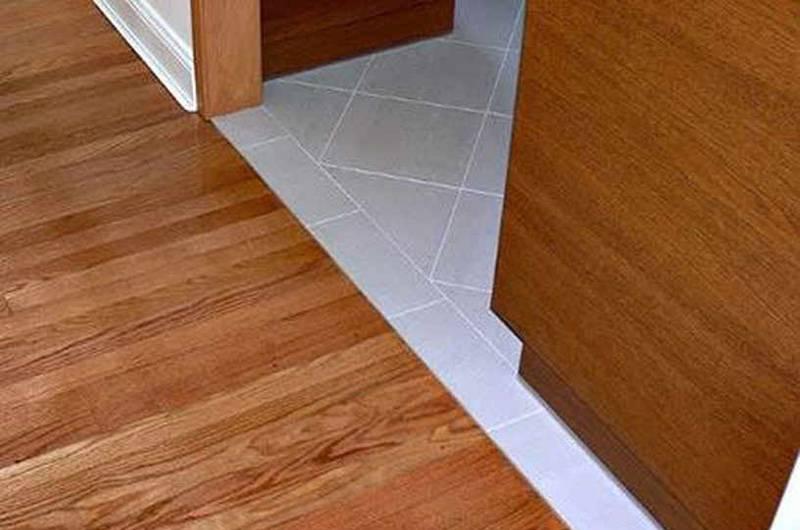 Порожек между плиткой и ламинатом: разновидности и способы стыковки порожков