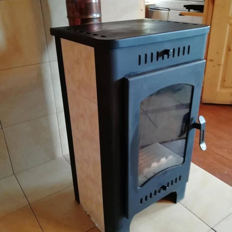 С камином-печью бавария в доме тепло и уютно