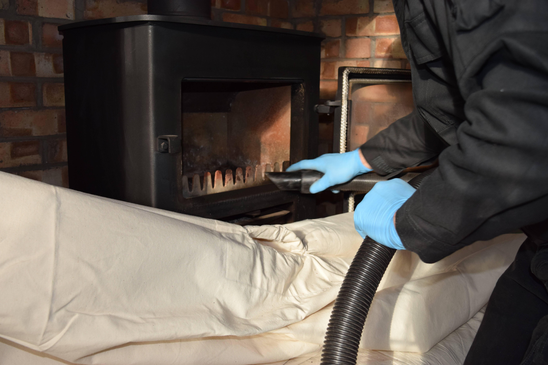Чем и как прочистить дымоход от сажи: особенности проведения работ