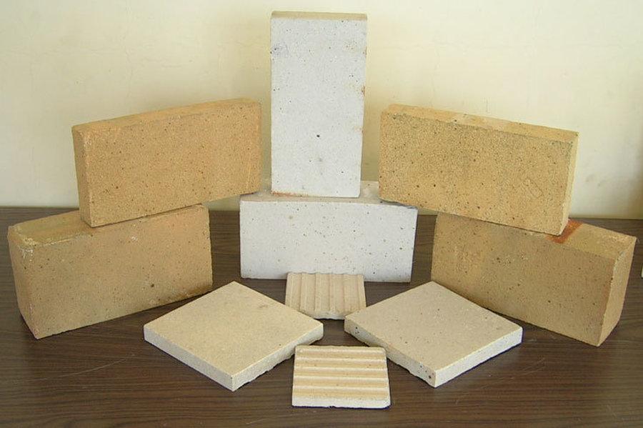 Облицовка поверхности огнеупорным материалом: как называется волокнистый, название негорючей плиты, для стен вокруг печей
